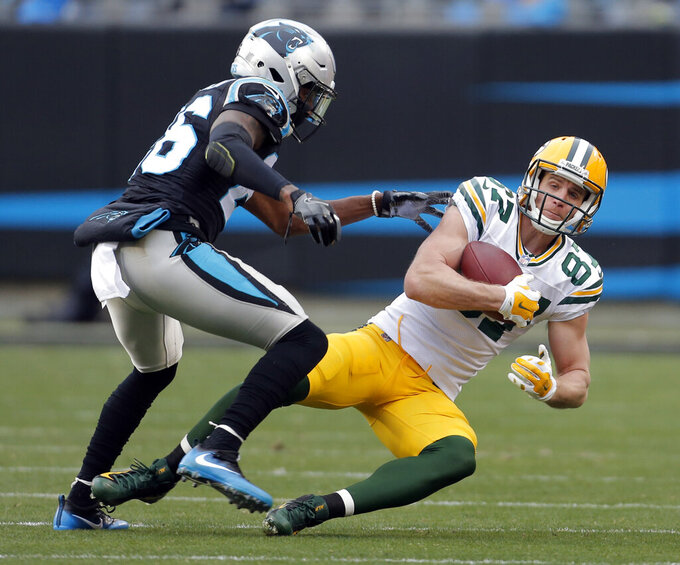 FILE - In this Dec. 17, 2017, file photo, Green Bay Packers' Jordy Nelson (87) catches a pass in front of Carolina Panthers' Daryl Worley (26) during the second half of an NFL football game in Charlotte, N.C. Veteran wide receiver Nelson is retiring as a member of the Packers. The 34-year-old played in Green Bay from 2008-2017, winning a Super Bowl with the Packers, before spending last season with the Oakland Raiders. Packers general manager Brian Gutekunst said Sunday, Aug. 4, 2019, that Nelson had informed the team of his decision. (AP Photo/Bob Leverone, File)