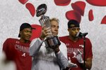 Alabama head coach Nick Saban holds up the trophy after their 31-14 win over Notre Dame in the Rose Bowl NCAA college football game in Arlington, Texas, Friday, Jan. 1, 2021. (AP Photo/Michael Ainsworth)