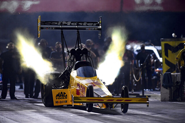 In this photo provided by the NHRA, Shawn Langdon takes part in Top Fuel qualifying Friday, Sept. 4, 2020, at the NHRA's U.S. Nationals drag races in Brownsburg, Ind. (Jerry Foss/NHRA via AP)