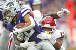 Oklahoma linebacker Nik Bonitto (11) tackles Kansas State running back Deuce Vaughn (22) during an NCAA college football game Saturday, Oct. 2, 2021 in Manhattan, Kan. (Ian Maule/Tulsa World via AP)