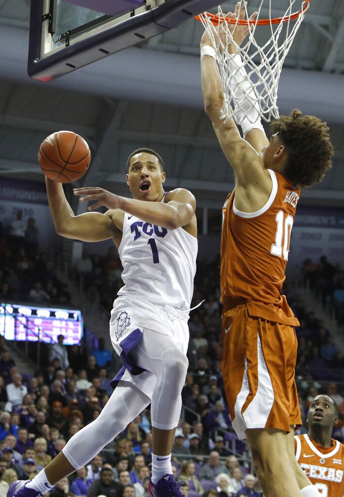 TCU guard Desmond Bane (1) drives to the basket against Texas forward Jaxson Hayes (10) during the second half of an NCAA college basketball game in Fort Worth, Texas, Wednesday, Jan. 23, 2019. TCU won 65-61.(AP Photo/LM Otero)