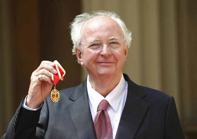 "FILE - In this Thursday May 16, 2019 file photo, author Philip Pullman with his knighthood following an investiture ceremony at Buckingham Palace, London. The line between fantasy and reality is blurry in the world of Philip Pullman. The British author's latest book, ""The Secret Commonwealth,"" is set in a world of mystery, magic, witches and daemons _ as well as untrustworthy politicians, manipulative charmers and fake news. (Yui Mok/Pool via AP, File)"