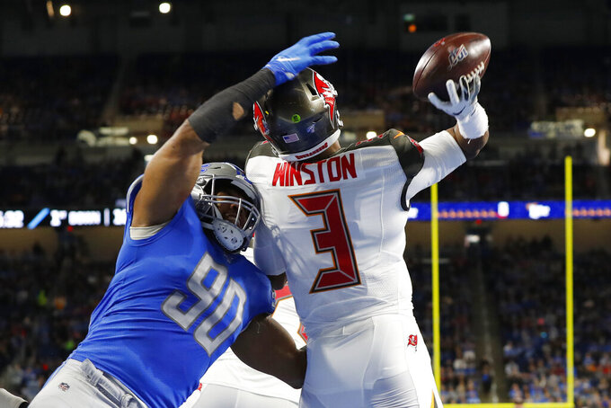 Tampa Bay Buccaneers quarterback Jameis Winston (3) throws before being hit by Detroit Lions defensive end Trey Flowers (90) during the first half of an NFL football game, Sunday, Dec. 15, 2019, in Detroit. (AP Photo/Paul Sancya)