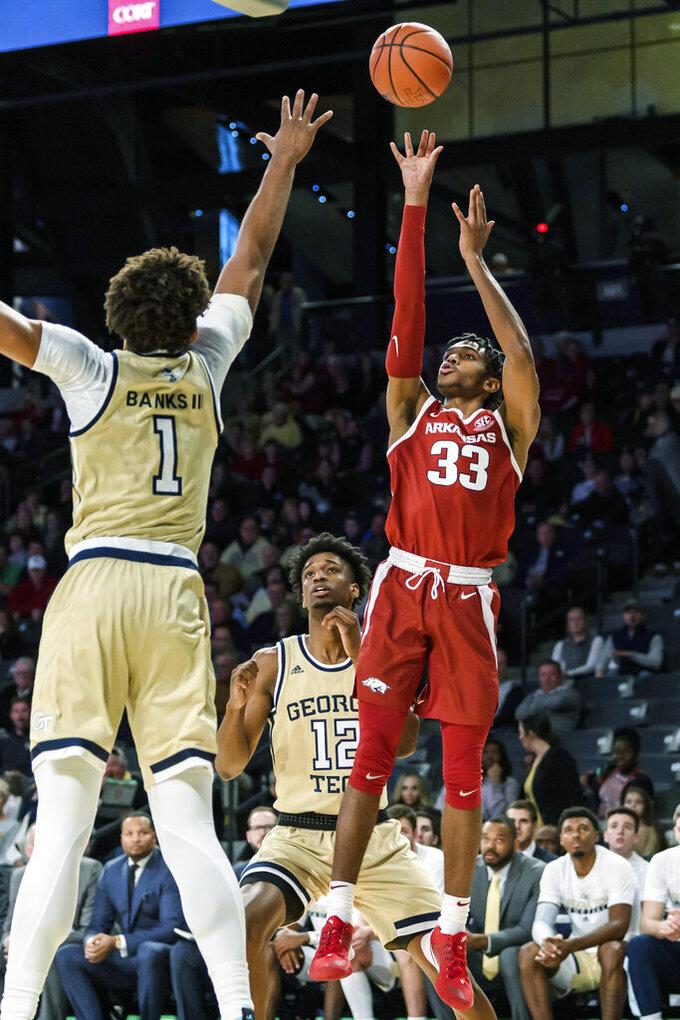 Arkansas guard Jimmy Whitt Jr. (33) shoots over Georgia Tech forward James Banks III (1) in the first half of an NCAA college basketball game Monday, Nov. 25, 2019, in Atlanta. (AP Photo/Danny Karnik)