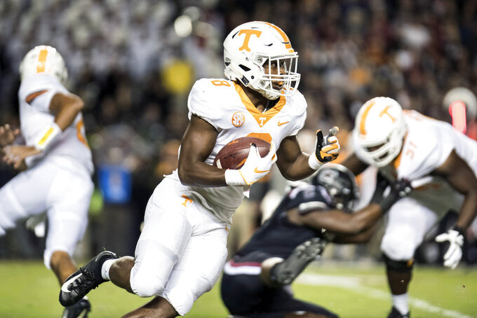 Tennessee running back Ty Chandler (8) runs the ball against South Carolina during the first half of an NCAA college football game Saturday, Oct. 27, 2018, in Columbia, S.C. (AP Photo/Sean Rayford)