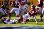 Washington Football Team quarterback Kyle Allen (8) injures his leg in a play against New York Giants strong safety Jabrill Peppers (21) in the first half of an NFL football game, Sunday, Nov. 8, 2020, in Landover, Md. (AP Photo/Patrick Semansky)