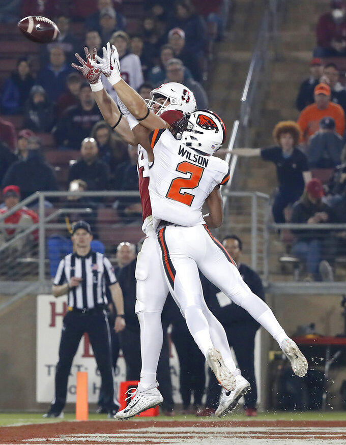 Stanford tight end Colby Parkinson (84) catches a touchdown pass against Oregon State cornerback Shawn Wilson (2) in the first half during an NCAA college football game on Saturday, Nov. 10, 2018, in Stanford, Calif. (AP Photo/Tony Avelar)