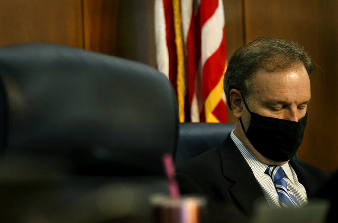 St. Louis County Executive Sam Page listens to the St. Louis County Council members cast their votes to repeal the mask mandate during a St. Louis County Council meeting on Tuesday, July 27, 2021, in Clayton, Mo. (Laurie Skrivan/St. Louis Post-Dispatch via AP)