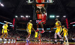 Houston Rockets' Clint Capela (15) dunks the ball as Golden State Warriors' Jordan Poole (3), Willie Cauley-Stein (2), Glenn Robinson III (22) and Ky Bowman (12) watch during the first half of an NBA basketball game Wednesday, Nov. 6, 2019, in Houston. (AP Photo/David J. Phillip)
