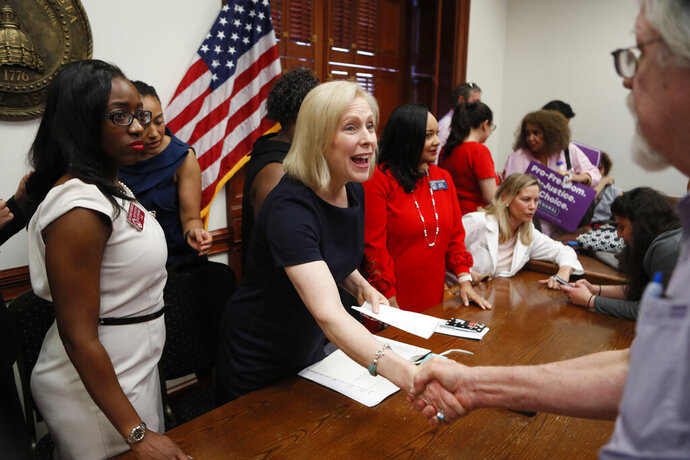 Presidential candidate Sen. Kirsten Gillibrand, D-N.Y., shakes hands with supporters after she held a roundtable discussion and news conference at the Georgia State Capitol in Atlanta on Thursday, May 16, 2019 to discuss abortion bans in Georgia and across the country. Georgia was the fourth state this year to pass anti-abortion