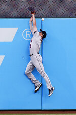 Houston Astros' Myles Straw makes a leaping attempt on a triple by Cleveland Indians' Oscar Mercado during the second inning of a baseball game Friday, July 2, 2021, in Cleveland. (AP Photo/Ron Schwane)