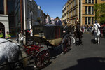 A carriage is driven through the streets of Windsor, England during a rehearsal for the procession of the upcoming wedding of Britain's Prince Harry and Meghan Markle,, England, Thursday, May 17, 2018. Preparations continue in Windsor ahead of the royal wedding of Britain's Prince Harry and Meghan Markle Saturday May 19. (AP Photo/Emilio Morenatti)