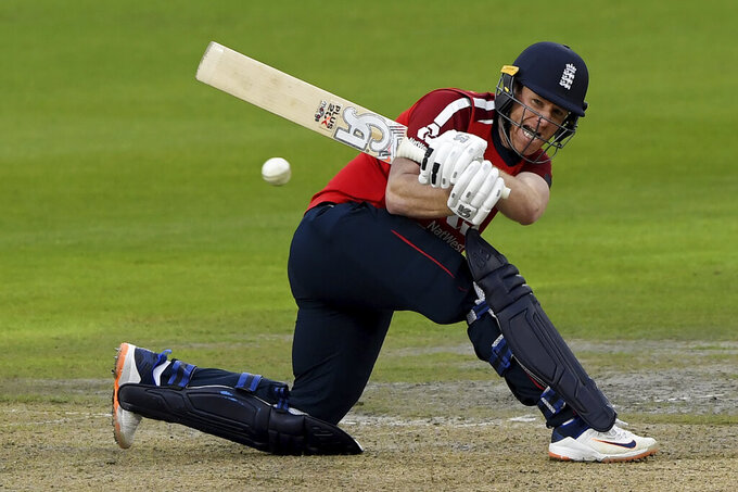 England's captain Eoin Morgan plays a shot during the first Twenty20 cricket match between England and Pakistan, at Old Trafford in Manchester, England, Friday, Aug. 28, 2020. (Mike Hewitt/Pool via AP)