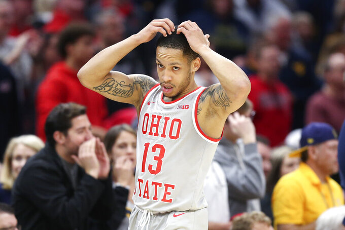 Ohio State's CJ Walker reacts during the second half of an NCAA college basketball game against West Virginia Sunday, Dec. 29, 2019, in Cleveland. West Virginia defeated Ohio State 67-59. (AP Photo/Ron Schwane)