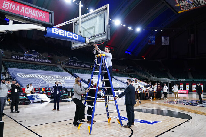 Iona head coach Rick Pitino cuts the net after winning an NCAA college basketball game against Fairfield during the finals of the Metro Atlantic Athletic Conference tournament, Saturday, March 13, 2021, in Atlantic City, N.J. (AP Photo/Matt Slocum)