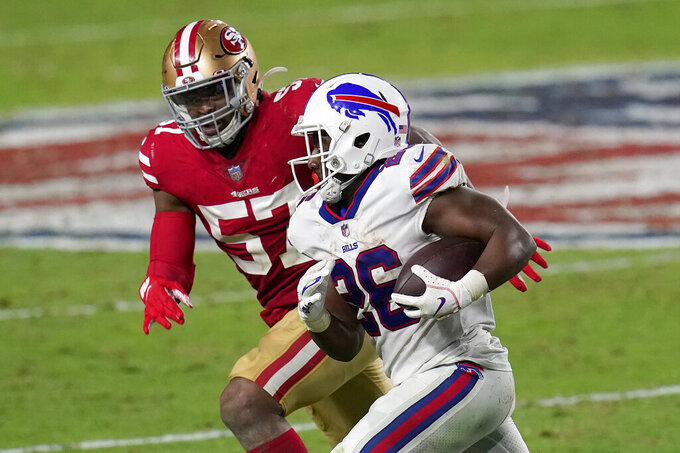 Buffalo Bills running back Devin Singletary (26) runs as San Francisco 49ers outside linebacker Dre Greenlaw (57) defends during the second half of an NFL football game, Monday, Dec. 7, 2020, in Glendale, Ariz. (AP Photo/Ross D. Franklin)