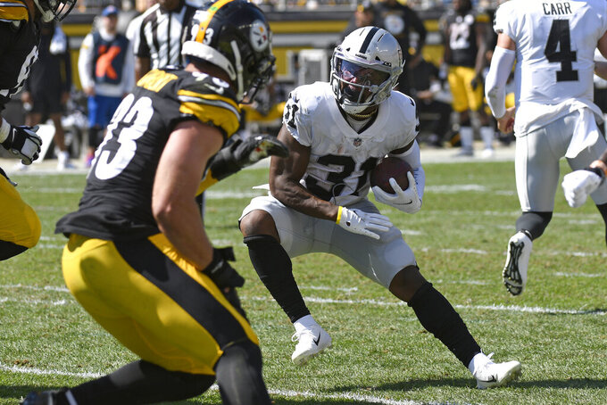 Las Vegas Raiders running back Peyton Barber (31) carries the ball during the first half of an NFL football game against the Pittsburgh Steelers in Pittsburgh, Sunday, Sept. 19, 2021. (AP Photo/Don Wright)