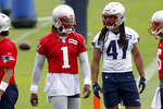 New England Patriots quarterback Cam Newton (1) talks with Jakob Johnson (47) during NFL football practice in Foxborough, Mass., Friday, June 4, 2021. (AP Photo/Mary Schwalm)