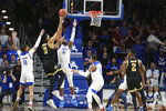 Wichita State center Jaime Echenique (21 )shoots over Tulsa forward Jeriah Horne (41) in the second half of Tulsa's 54-51 win over Wichita State in an NCAA college basketball game in Tulsa, Okla., Saturday, Feb. 1, 2020. (AP Photo/Joey Johnson)