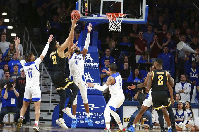 Wichita State center Jaime Echenique (21 )shoots over Tulsa forward Jeriah Horne (41) in the second half of Tulsa's 54-51 win over Wichita State in an NCAA college basketball game in Tulsa, Okla., Saturday, Feb. 1, 2020. (AP Photo/Joey Johnson)