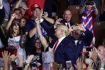 Supporters cheer as President Donald Trump arrives to a campaign rally, Thursday, Aug. 15, 2019, in Manchester, N.H. (AP Photo/Elise Amendola)