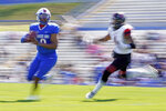 Tennessee State quarterback Deveon Bryant, left, scrambles from Southeast Missouri State linebacker Omardrick Douglas during an NCAA college football game Sunday, April 11, 2021, in Nashville, Tenn. Because of COVID-19, the OVC postponed the 2020 season to the spring, and the decision was made to play games on Sunday because member schools needed flexibility to staff all the spring sports. (AP Photo/Mark Humphrey)