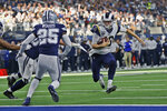Los Angeles Rams quarterback Jared Goff (16) is about to be stopped short of the goal line by Dallas Cowboys outside linebacker Sean Lee, left, as Cowboys' Xavier Woods (25) moves in during the first half of an NFL football game in Arlington, Texas, Sunday, Dec. 15, 2019. (AP Photo/Roger Steinman)