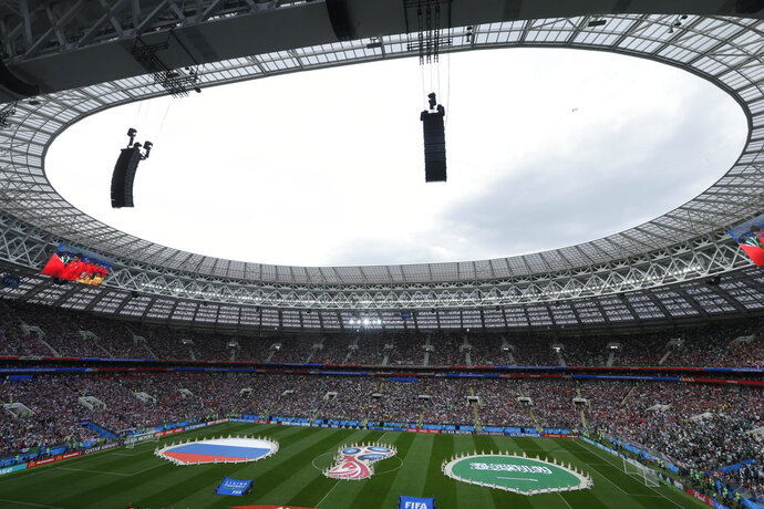 Performers display the 2018 soccer World Cup logo and the colors of Russia and Saudi Arabia prior to their group A match which opens the tournament at the Luzhniki stadium in Moscow, Russia, Thursday, June 14, 2018. (AP Photo/Victor Caivano)