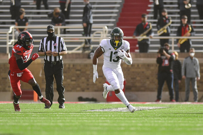 Baylor running back Qualan Jones (13) runs with the ball against Texas Tech during the first half of an NCAA college football game in Lubbock, Texas, Saturday, Nov. 14, 2020. (AP Photo/Justin Rex)