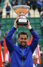 Italy's Fabio Fognini poses with a trophy after defeating Serbia's Dusan Lajovic in the men's singles final match of the Monte Carlo Tennis Masters tournament in Monaco, Sunday, April, 21, 2019. (AP Photo/Claude Paris)
