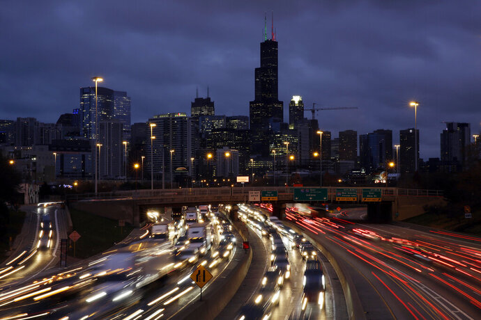 FILE - In this Nov. 21, 2018, file photo taken with a long exposure, traffic streaks across the John F. Kennedy Expressway at the start of the Thanksgiving holiday weekend in Chicago. The Transportation Security Administration said Wednesday, Nov. 13, 2019, that it expects to screen more than 26.8 million passengers from Nov. 22 through Dec. 2, a 4% increase over the comparable period last year. (AP Photo/Kiichiro Sato, File)