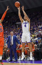 LSU guard Skylar Mays (4) shoots a 3-pointer as Auburn head coach Bruce Pearl, background, watches in the first half of an NCAA college basketball game, Saturday, Feb. 9, 2019, in Baton Rouge, La. (AP Photo/Bill Feig)