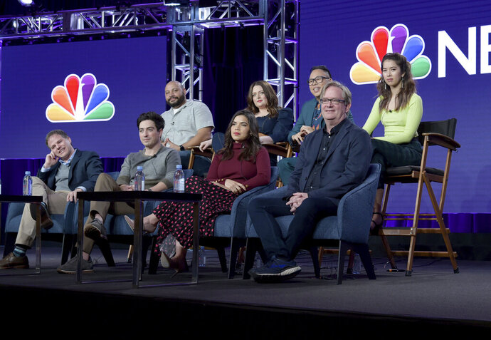 Executive producer Justin Spitzer, from front row left, Ben Feldman, America Ferrera, Mark McKinney and from back row left, Colton Dunn, Lauren Ash, Nico Santos and Nichole Bloom participate in NBC's