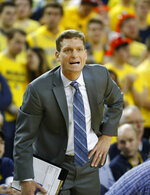 FILE - In this Jan. 3, 2019, file photo, then-Michigan assistant coach Luke Yaklich gives instructions in the first half of an NCAA college basketball game against Penn State in Ann Arbor, Mich. Yaklich is the new basketball head coach at the University of Illinois at Chicago. Yaklich has three Division I transfers and two junior-college transfers joining the program he took over in March. (AP Photo/Paul Sancya, File)