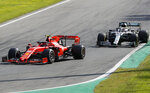 Ferrari driver Charles Leclerc of Monaco is chased by Mercedes driver Lewis Hamilton of Britain during the Formula One Italy Grand Prix at the Monza racetrack, in Monza, Italy, Sunday, Sept.8, 2019. (AP Photo/Antonio Calanni)