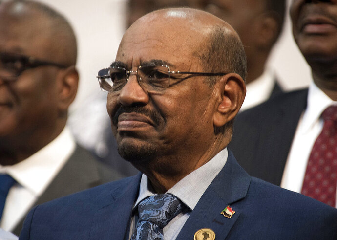 FILE - In this June 14, 2015 file photo, Sudanese President Omar al-Bashir smiles during a visit to Johannesburg, South Africa. Sudan's sate-run news agency said Sunday, Feb. 17, 2019, that a parliamentary committee tasked with amending the constitution to allow al-Bashir to run for another term has abruptly canceled its meeting that was scheduled for Sunday for