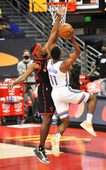 Toronto Raptors' Paul Watson defends Oklahoma City Thunder's Theo Maledon (11) during the first quarter of a basketball game Sunday, April 18, 2021, in St. Petersburg, Fla. (AP Photo/Steve Nesius)