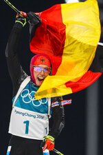 Laura Dahlmeier, of Germany, waves the German flag as she wins the gold medal in the women's 10-kilometer biathlon pursuit at the 2018 Winter Olympics in Pyeongchang, South Korea, Monday, Feb. 12, 2018. (AP Photo/Andrew Medichini)