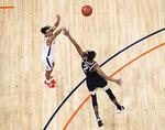 Virginia guard Kihei Clark shoots over Wake Forest's Jalen Johnson during an NCAA college basketball game Wednesday, Jan. 6, 2021, in Charlottesville, Va. (Erin Edgerton/The Daily Progress via AP, Pool)