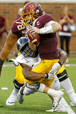 Georgia Southern linebacker Reynard Ellis (36) sacks Minnesota quarterback Tanner Morgan (2) in the fourth quarter of an NCAA college football game Saturday, Sept. 14, 2019, in Minneapolis. (AP Photo/Bruce Kluckhohn)