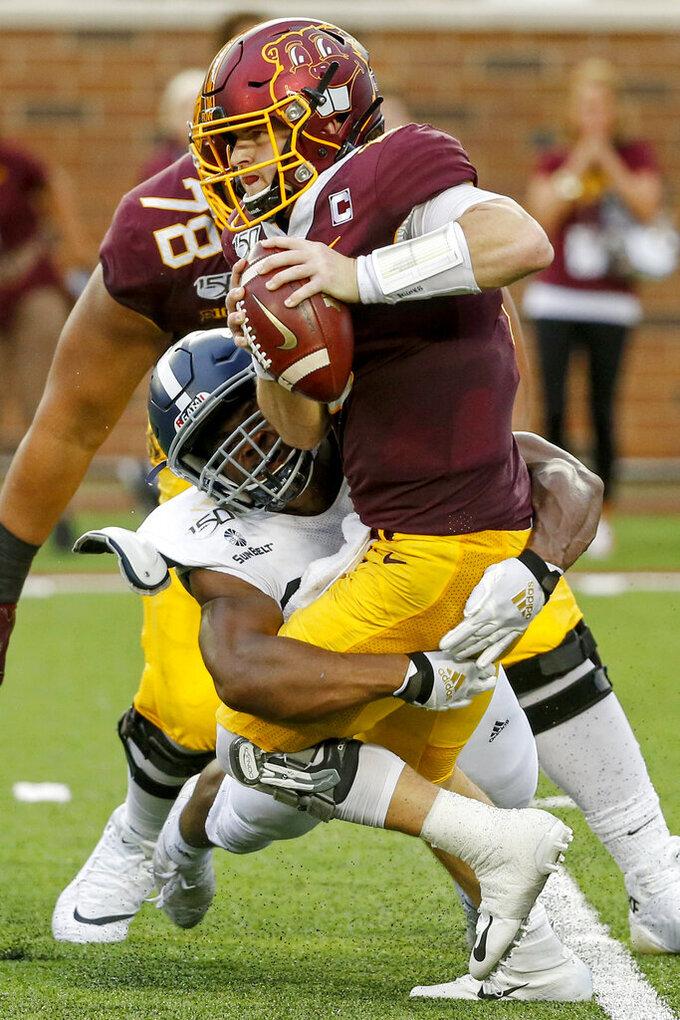 Georgia Southern linebacker Reynard Ellis (36) sacks Minnesota quarterback Tanner Morgan (2) in the fourth quarter of an NCAA college football game Saturday, Sept. 14, 2019, in Minneapolis. (AP Photo/Bruce Kluckhohn)
