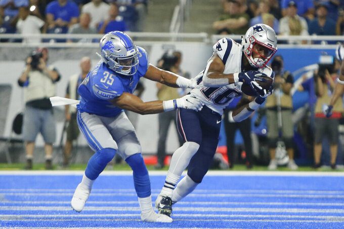 New England Patriots receiver Jakobi Meyers, defended by Detroit Lions defensive back Miles Killebrew (35), catches a touchdown pass during the first half of a preseason NFL football game Thursday, Aug. 8, 2019, in Detroit. (AP Photo/Duane Burleson)