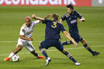 Atlanta United's Josef Martinez, left, battles with Philadelphia Union's Jack Elliott, center, for the ball as Philadelphia Union's Leon Flach, right, looks on during the first half of a CONCACAF Champions League soccer match, Tuesday, May 4, 2021, in Chester, Pa. (AP Photo/Chris Szagola)