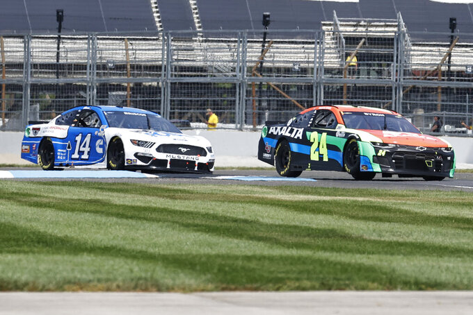 William Byron (24) and Chase Briscoe (14) drive duringa NASCAR Series auto race at Indianapolis Motor Speedway, Sunday, Aug. 15, 2021, in Indianapolis. (AP Photo/Rob Baker)
