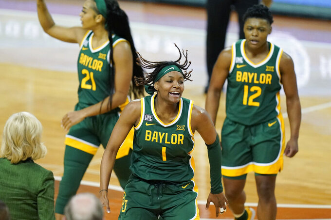 FILE - Baylor forward NaLyssa Smith (1) celebrates a score against Texas with teammates during the second half of an NCAA college basketball game in Austin, Texas, in this Monday, March 1, 2021, file photo. The Lady Bears take a 14-game winning streak into the Big-12 tournament. Junior forward NaLyssa Smith is the leading scorer for Baylor. (AP Photo/Eric Gay, File)