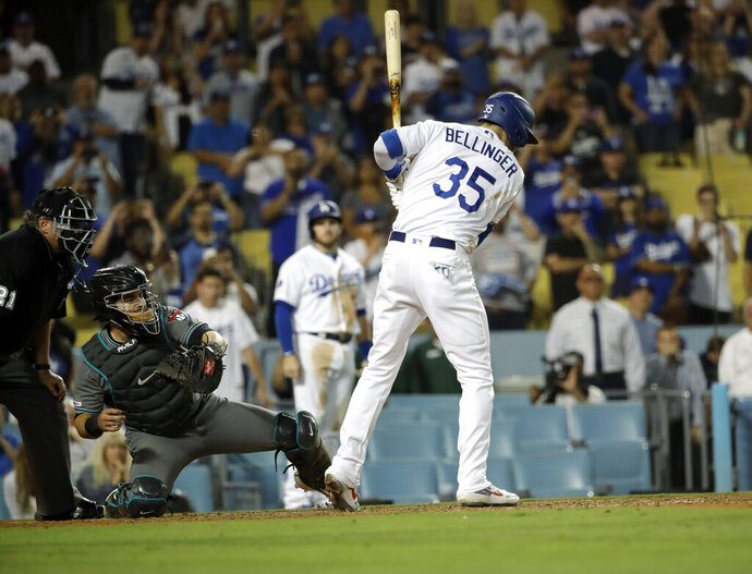 Los Angeles Dodgers' Cody Bellinger (35) is walked with the bases loaded for the last run of a baseball game against the Arizona Diamondbacks during the ninth inning Tuesday, July 2, 2019, in Los Angeles. Los Angeles won 5-4. (AP Photo/Marcio Jose Sanchez)