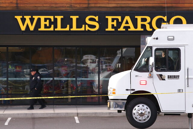 An attacker stabbed multiple people at a suburban Portland shopping center Wednesday, killing one person and wounding others before being apprehended, authorities said. Police in the city of Beaverton said that at least one person was stabbed inside a Wells Fargo bank and that multiple people were taken to hospitals. (Beth Nakamura/The Oregonian via AP)
