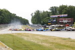 Alex Palou, third from right, competes during an IndyCar race at Road America in Elkhart Lake, Wisc., Sunday, June 20, 2021. (AP Photo/Jeffrey Phelps)