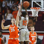 Virginia Tech's Jalen Cone (15) shoots over the defense Syracuse's Buddy Boeheim (35) during the first half of an NCAA college basketball game in Blacksburg Va., Saturday, Jan. 18 2020. (Matt Gentry/The Roanoke Times via AP)