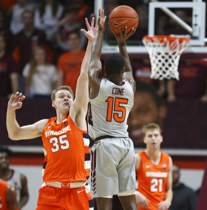 Virginia Tech's Jalen Cone (15) shoots over the defense Syracuse's Buddy Boeheim (35) during the first half of an NCAA college basketball game in Blacksburg Va., Saturday, Jan. 18 2020. (Matt Gentry/The Roanoke Times via AP)
